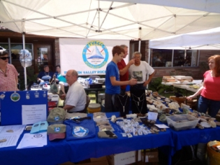 Tualatin Valley Rock and Gem Club volunteers help out with display.
